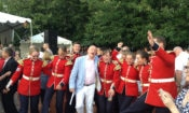 Ambassador Heyman dances with members of the Governor General's Ceremonial Band at the Embassy's Fourth of July party.