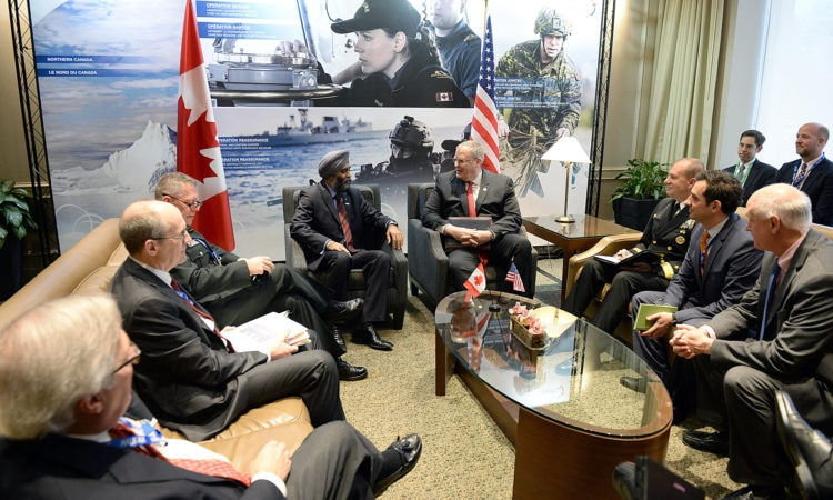 Deputy Defense Secretary Bob Work meets with Canadian Minister of National Defense Harjit Sajjan at the Halifax International Security Forum in Nova Scotia, Canada.