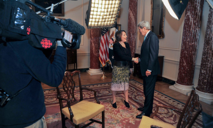 U.S. Secretary of State John Kerry greets CBC host Rosemary Barton on March 9, 2016, at the U.S. Department of State in Washington, D.C., before an interview in advance of the State Visit of Canadian Prime Minister Justin Trudeau. [State Department photo/ Public Domain]