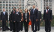"Back dropped by a monument depicting Cuba's revolutionary hero Ernesto ""Che"" Guevara, U.S. President Barack Obama, Vice-President of Cuba's State Council Salvador Valdes Mesa, right, and other members of the U.S. delegation stand during a ceremony at the Jose Marti Monument in Havana, Cuba, Monday March 21, 2016. ""It is a great honor to pay tribute to Jose Marti, who gave his life for independence of his homeland. His passion for liberty, freedom, and self-determination lives on in the Cuban people today,"" Obama wrote in dark ink in the book after he laid a wreath and toured the memorial dedicated to the memory of Jose Marti. (AP Photo/Dennis Rivera) - Puerto Rico OUT"