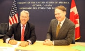 CRTC Chair Jean-Pierre Blais signs the Memorandum of Understanding with the FTC as Acting Chargé d'affaires
