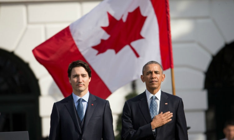 President Barack Obama and Canadian Prime Minister Justin Trudeau, stand for the playing of national anthems during an arrival ceremony on the South Lawn of the White House in Washington, Thursday, March 10, 2016. (AP Photo/Andrew Harnik)