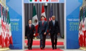 Mexican President Enrique Pe–a Nieto (L), Canada's Prime Minister Justin Trudeau, and President of the United States Barack Obama arrive to the North American Leaders Summit at the National Gallery of Canada in Ottawa June 29, 2016. Photo by Blair Gable