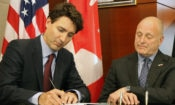 Canadian Prime Minister Justin Trudeau signs Embassy Ottawa's book of condolences for victims of the Orlando shooting as Ambassador Bruce Heyman looks on. (Credit US Embassy Ottawa)