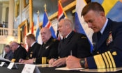 Coast Guard COmmandant Adm. Paul Zukunft (right) and the heads of seven other Arctic nations' coast guards sign a joint statement that establishes the frameworks that detail the development of a multi-year strategic plan, avenues to share information, highlight best practices, identify training exercises, and on-the-water combined operations to achieve safe, secure and environmentally-responsible maritime activity in the Arctic in Faneuil Hall in Boston, June 10, 2016. U.S. Coast Guard photo by Petty Officer 2nd Class Patrick Kelley.