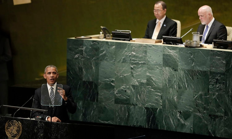 President Barack Obama addresses the 71st session of the United Nations General Assembly in New York, N.Y., Tuesday, Sept. 20, 2016. UN Secretary General Ban Ki-moon, center, and Peter Thomson of Fiji, President of its seventy-first session listen. (AP Photo/Carolyn Kaster)