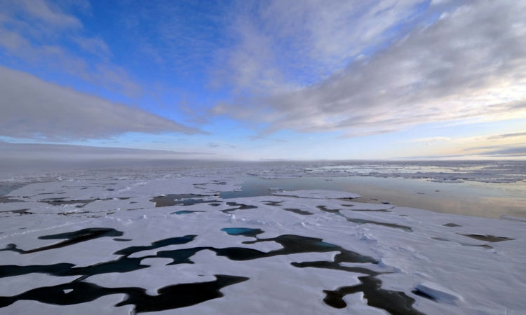 The clouds begin to thin over the Arctic Ocean Aug. 19, 2009. (Credit US Geological Survey)