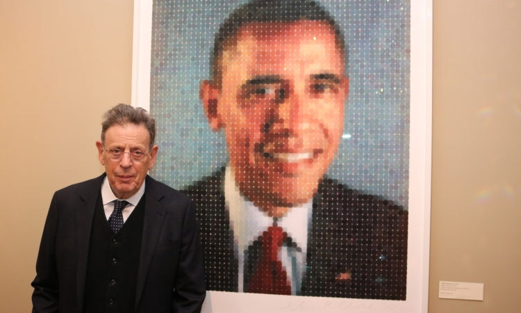 Philip Glass poses with a portrait of President Barack Obama. Credit US Embassy Ottawa.