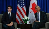 U.S. President Barack Obama, right, speaks during a meeting with Canada's Prime Minister Justin Trudeau at the Asia-Pacific Economic Cooperation (APEC), in Lima, Peru, Sunday, Nov. 20, 2016. (AP Photo/Pablo Martinez Monsivais)