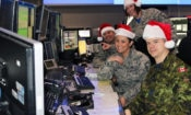Eastern Air Defense Sector (EADS) personnel conduct training in preparation for Santa tracking operations at their headquarters in Rome, N.Y. on Dec. 11, 2016. Pictured from front to back, are: Sgt. Thomas Vance of the Royal Canadian Air Force, a member of EADS Canadian Detachment; and Master Sgt. Michelle Gagnon, Master Sgt. Lena Kryczkowski (standing) and Master Sgt. Shane Reid, all members of the New York Air National Guard's 224th Air Defense Squadron.