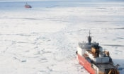 United States Coast Guard Cutter HEALY backs up to assist the Canadian Coast Guard Heavy Icebreaker Louis S. St-Laurent, 2011. Debbie Hutchinson/USGS