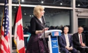 Chargé d'affaires Elizabeth Aubin welcomes guests to the International Pavilion. Credit US Embassy Ottawa.