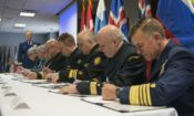 U.S. Coast Guard Commandant Adm. Paul Zukunft joins leaders representing eight coast guard agencies of Arctic nations in signing a joint statement in Boston, Friday, March 24, 2017. The statement adopts doctrine, tactics, procedures and information-sharing protocols for emergency maritime response and combined operations in the Arctic. U.S. Coast Guard photo by Petty Officer 2nd Class Cynthia Oldham